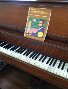 Piano Stewart family with Joplin book