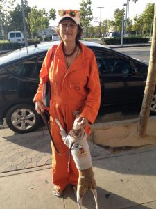 Lady in cool orange Dickies jumpsuit with Fifi